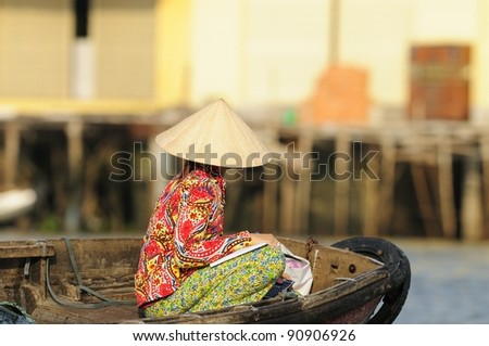 Vietnamese Woman Seen on a Boat at a Morning Floating Market (Can Tho) in the Mekong Delta. - stock photo
