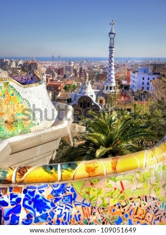 Vieuw over the city of Barcelona from the Park Guell with his famous colorful mosaic seats - stock photo