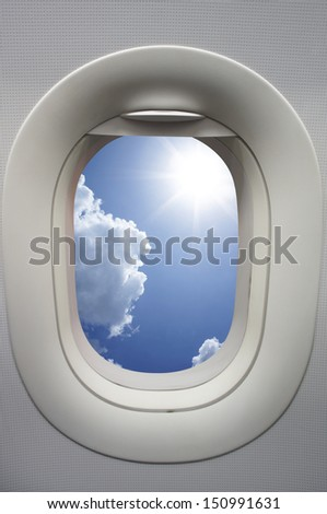 View above clouds from window with airplane  - stock photo