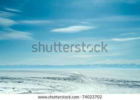 view above frozen lake in winter - stock photo