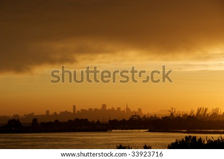 View accross San Francisco Bay from Alameda with marina and city silhouette - stock photo
