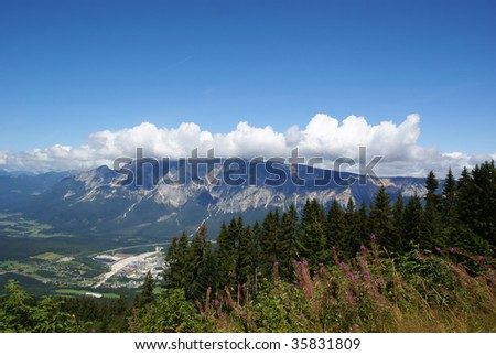 View across a valley in Carinthia/Austria to the Dobratsch Mountain at a clear and sunny day showing all the beauty of Austria. - stock photo