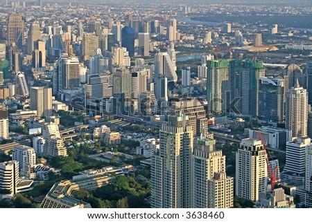 View across Bangkok skyline showing office blocks and condominiums - stock photo