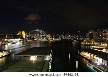 View across Circular Quay to the Sydney Harbour Bridge. One of Sydney's most iconic landmarks. - stock photo
