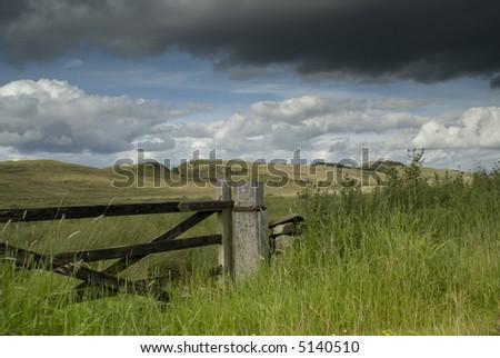 View across farmland in the Lake District - landscape orientation - stock photo