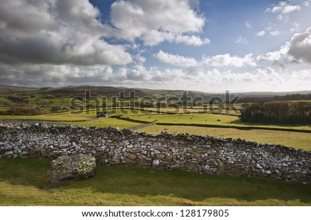 View across fields towards Wharfe Dale in Yorkshire Dales National Park - stock photo