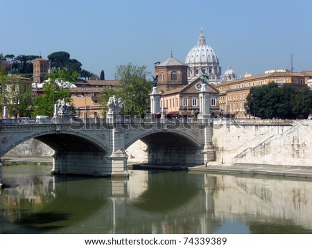 view across river tiber to st peters