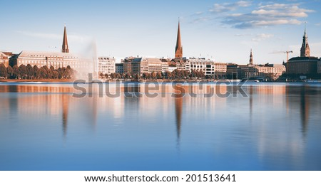 View across the Inner Alster Lake in Hamburg, Germany, toned image - stock photo