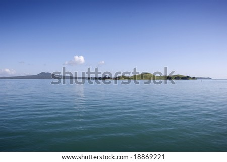 view across the water to two islands in Auckland harbour