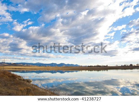 View across to the far shore of a lake on the Colorado prairie near Boulder - stock photo