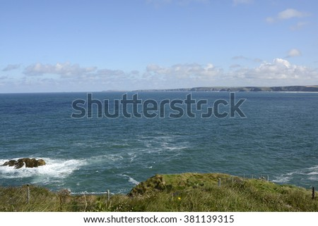 View across Watergate Bay from Newquay in Cornwall, England - stock photo