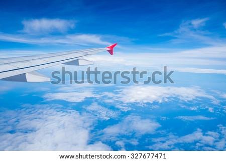 View airplane cloudy blue indigo sky  - stock photo