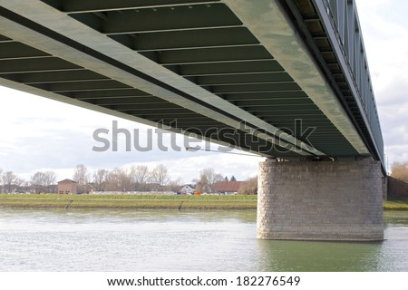 View along a steel bridge across the River Rhine - stock photo