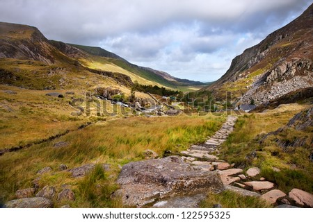View along Nant Francon mountain valley in Snowdonia National Park in Wales - stock photo