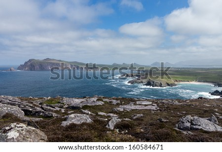 View along the coastline to Sybil Head on the western point of County Kerry near Dingle in Ireland or Eire. This headland is shaped like the Sydney Opera House - stock photo