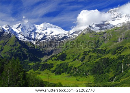View at alpine mountain peaks - Grossglockner - covered by snow - stock photo