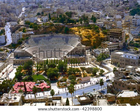 View at Amman the captal of Jordan,with the roman amphitheatre. no number plates,no brands and no people recognizable - stock photo