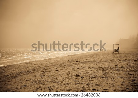 View at beach in fog photo 2 - stock photo