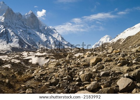 View at Bhagirathi Parbat and Gomukh glacier, India. The Parbat is a chine with peaks of 6510, 6450 and 6860m high. Gangotri glacier is 30 km long, and here Ganga (Bhagirathi) river begins from. - stock photo