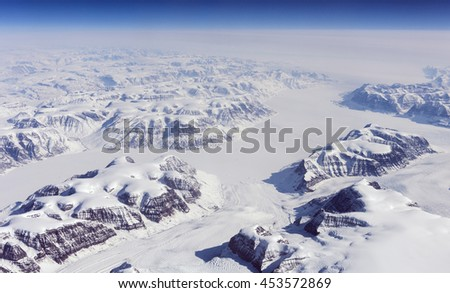 View at Greenland frozen mountains from above