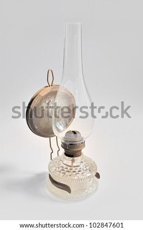 view at old isolated kerosene lamp - stock photo