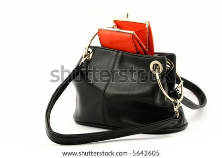 View at open empty red wallet put in a black handbag on a white background