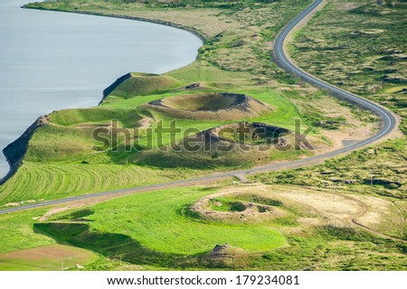 View at pseudocraters from the Vindbelgur volcano near the lake Myvatn - northern Iceland - stock photo