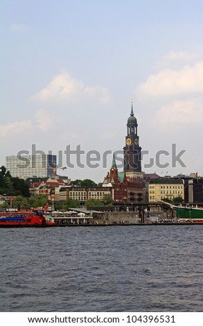 View at St. Michaelis Church in Hamburg from other riverside - stock photo