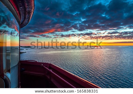 View at sunset from the top of Kjeungskjaer lighthouse, Orland, Norway - stock photo