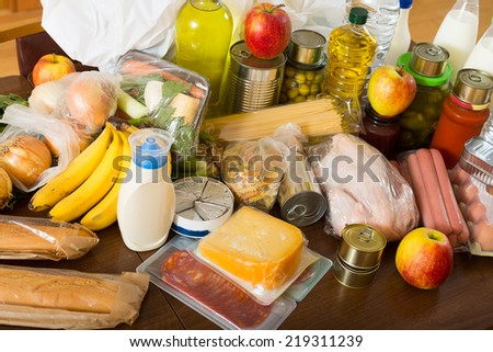 View at table with articles of food for  family  in home - stock photo