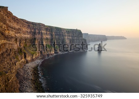 View at the Cliffs of Moher during the sunset. - stock photo