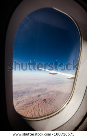 View at the earth from window of airplane - stock photo