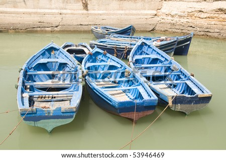 View at the fishing boats from port in Essaouira - stock photo