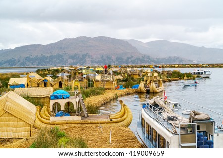 View at the Floating Island Los Uros with typical boats in Lake Titicaca, Puno, Peru - stock photo