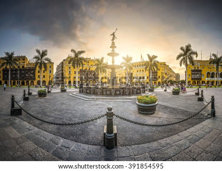 View at the sunset of the antique iron pool of the main square of Lima, Peru. - stock photo