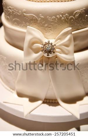 View at the white wedding cake - stock photo
