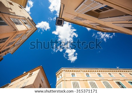 View at top of the houses and blue sky with clouds at Aix-en-Provence, France - stock photo