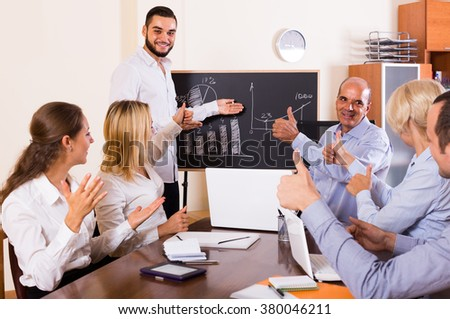 View at working meeting european people with diagram at background - stock photo