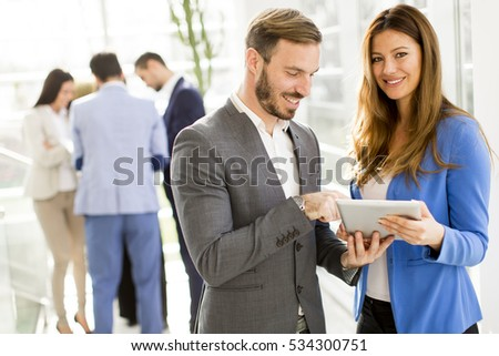 View at young business couple using tablet in the office