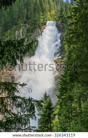 View beauty Alpine inspiring Krimml waterfall in mountains, clear blue sky, deep rich green forest, spruce, trees. summer day. trekking in National park Hohe Tauern, Austria, Europe. Poster Image - stock photo