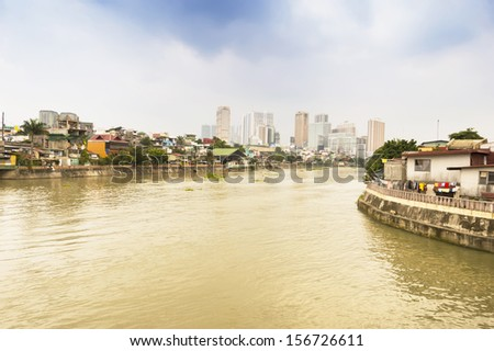 view buildings and Pasig river in Intramuros district, Manila, Philippines - stock photo