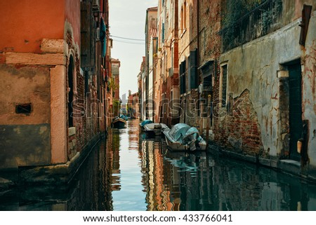 View Canal with boats from bridge in Venice, Italy. Venice is a popular tourist destination of Europe. - stock photo