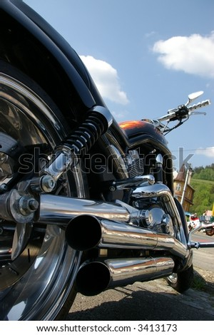 View chrome exhaust on Harley chopper.