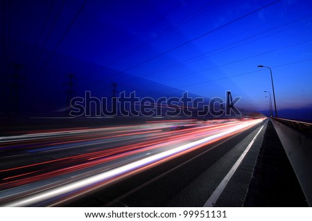 View City-highway vehicles in the evening rainbow light trails - stock photo