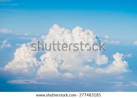 view Clouds and sky from airplane window - stock photo