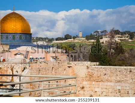 View Dome of the Rock and Temple Mount in Jerusalem with melting snow - stock photo