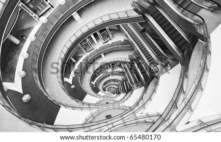 View down in a modern hall. Image looks like infinity twisted spiral. - stock photo