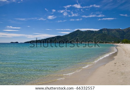 view down the length of idyllic Golden beach toward the headland at Skala Potamia, Thassos, Greece - stock photo