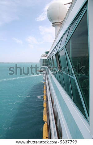 View down the side of a moving cruise ship