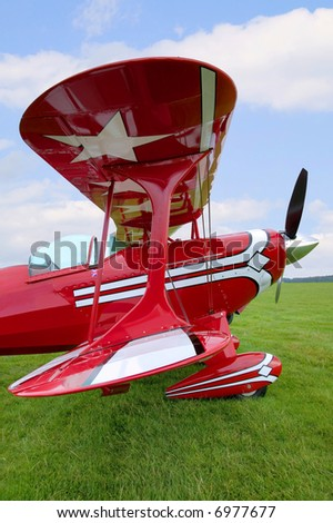 View down the wings of an old red biplane. - stock photo